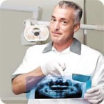 The dentist analyzes the X-ray to prepare a detailed Cost-Estimate